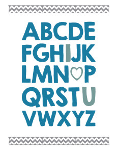 Alphabet written in thick blue letters with I, O replaced by a heart, and U in lighter blue and chevron washi tape above and below.
