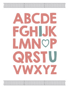Alphabet written in thick pink letters with I, O replaced by a heart, and U in blue and chevron washi tape above and below.