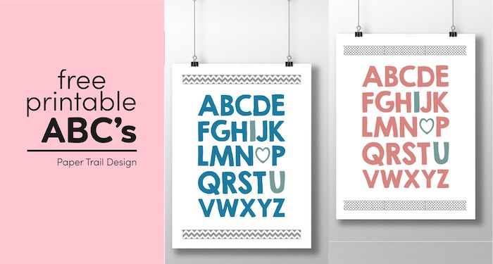 Two wall art prints in blue and pink with the complete ABC's with I, heart, and U written in a different colors suspended from clips with text overlay-free printable ABC's.