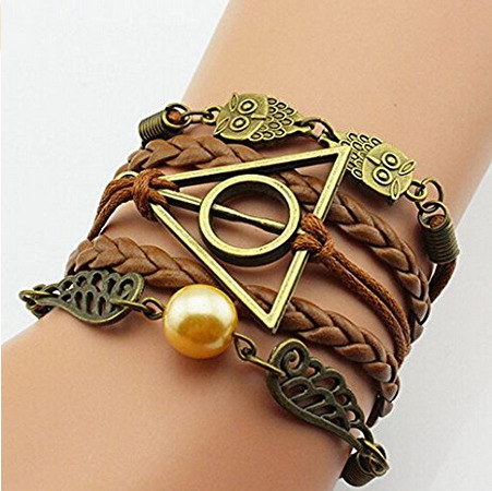 Harry Potter deathly hallows, owl, and golden snitch discreet bracelet is one of the best Harry Potter gifts.