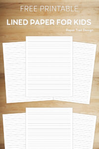 Kids lined handwriting paper on a wooden background with text overlay free printable lined paper for kids