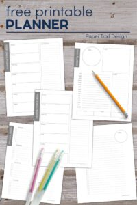 Planner printables on desk with pencil and gel pens with text overlay free printable planner