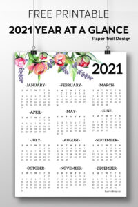 2021 one page calendar with floral elements hanging from two wires attached to clips with text overlay- free printable 2021 year at a glance