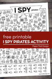 Pirate themed I spy kids activity page on a wood background with text overlay- free printable I Spy Pirates activity