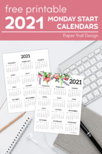 plain and floral 2021 monday start one page calendars on a computer keyboard with notepad and pen with text overlay- free printable 2021 monday start calendars