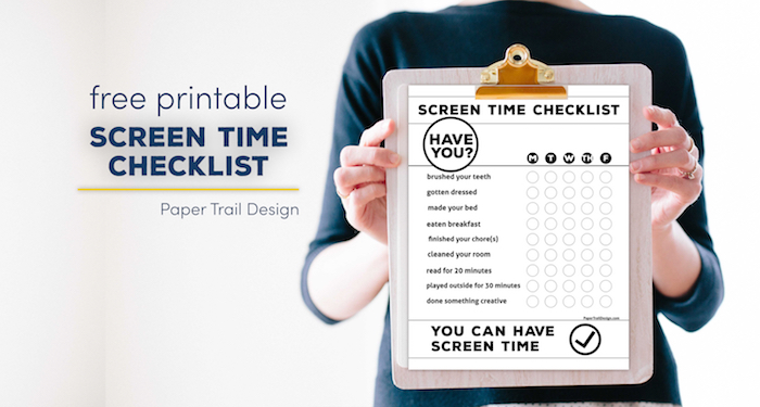 Woman holding clipboard with screen time checklist attached with text overlay- free printable screen time checklist