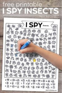 I spy insects page with kids hand holding a marker with text overlay- free printable I spy insects