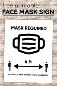 Face mask required sign with six feet arrows between two people with text overlay- free printable face mask sign