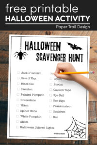 Halloween scavenger hunt list with kids hand holding pencil with text overlay- free printable Halloween activity