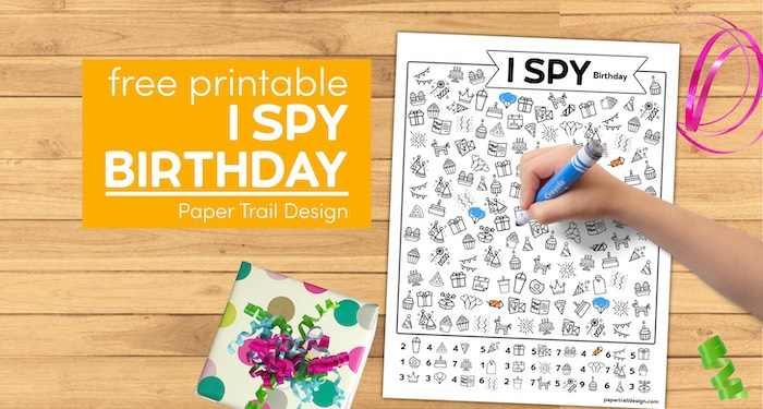Kids I spy activity page with kids hand holding marker and gift over with text overlay- free printable I spy birthday