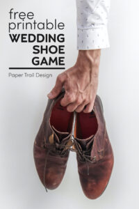 Man's arm holding dress shoes with text overlay- free printable wedding shoe game