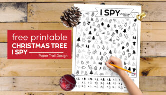 Christmas tree themed I spy activity with kid's hand holding pencil with text overlay- free printable Christmas tree I spy