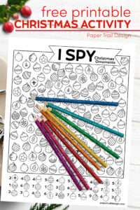 I spy Christmas ornament activity page with colored pencils with text overlay- free printable Christmas activity
