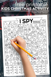 Christmas I spy page and kid's hand holding pencil with text overlay- kids Christmas activity
