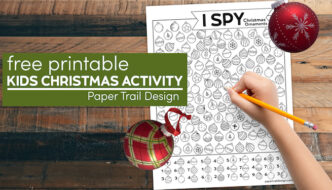 I spy Christmas ornament activity with child's hand holding pencil and text overlay- free printable kids Christmas activity