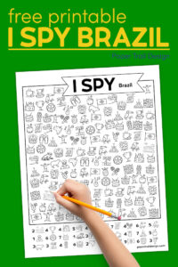 Kids Brazil themed I spy page with kids hand holding pencil with text overlay- free printable I spy Brazil