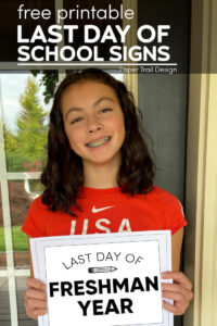 Girl holding last day of freshman year sign with text overlay-free printable last day of school signs