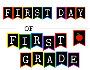 Colorful first day of first grade sign with apple