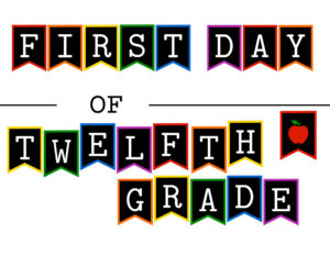 Colorful first day of twelfth grade sign with apple
