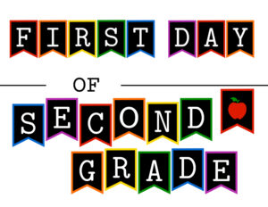 Colorful first day of second grade sign with apple