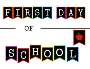 Colorful first day of school sign with apple