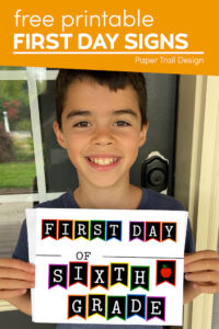 Boy holding colorful first day of sixth grade sign with text overlay- free printable first day signs