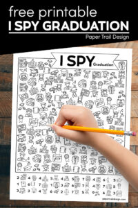 Kids graduation game to play with kid's hand holding pencil with text overlay- free printable I spy graduation