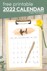 Watercolor April 2022 calendar printable page on clipboard with text overlay- free printable 2022 calendar