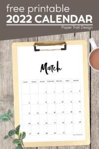 2022 March calendar page on clipboard with text overlay- free printable 2022 calendar