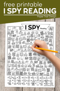Kids reading themed activity page with kids hand holding pencil with text overlay- free printable I spy reading activty